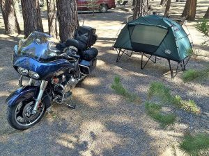 motorcycle camping with tent cot